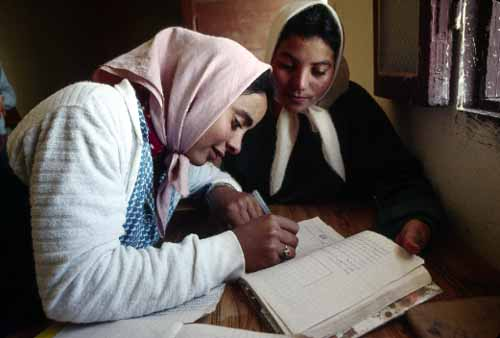 [Image: Young women in an adult literacy class in Makthar, Tunisia. (UN Photo #157607)]